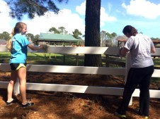 Kate and a local highschooler make sure the fence is sparkling clean.